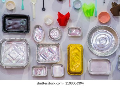 Advertising, Business, Food Concept - Collection of Packages design for bakery. Paper cup for cupcake and muffins, Various shape of the foil for food. Aluminium utensils for baking. Selective focus