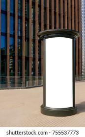 Advertising column mockup. Blank billboard outdoors, outdoor advertising, public information board in the city