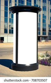 Advertising column mockup. Blank public information board mock up in front of the modern architecture building