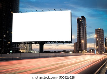 Advertising concept, Blank template  for outdoor advertising or blank billboard on the highway during the twilight. With clipping path on screen - can be used for trade shows, promotional poster.
