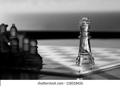 Advertising: King chess pieces as business concept series: advertise, strategy, be seen,  advertising concept / mentor, consultant, CEO, leadership - King in light, other pieces in dark - advertising!