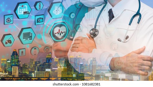 Advertising, Medical network Concept - Cropped image of Team of doctors and nurses with stethoscopes with background blur building skyscrapers at sunset and Abstract medical science and health icons.