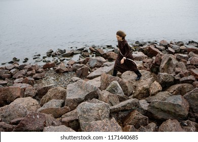 advertising photography girl near the water, clothing collection