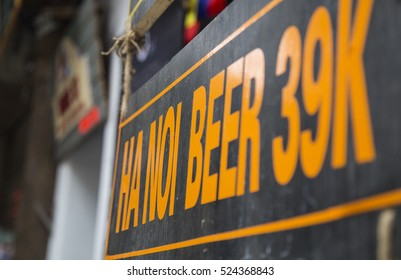 Advertising sign for Hanoi beer, the popular drink in Hanoi, hang outside of a side walk restaurant at Hanoi old quarter street area.