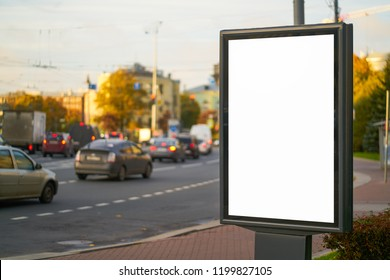 advertising space under the poster. Lightposter citylight mockup small billboard in the city near the roadway. white space for advertising