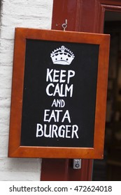 Advertising text on a blackboard : Keep calm eat a burger