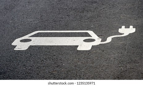 Advice symbol for an electric filling station on the asphalt of a street in Leipzig