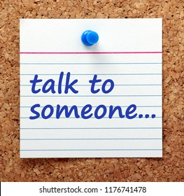 Advice to Talk To Someone written on a card pinned to a cork notice board as a reminder to share your problems