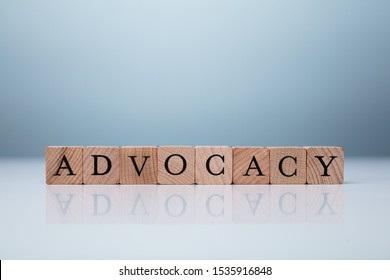 Advocacy Word Made Using Wooden Blocks. Brand Advocacy Concept