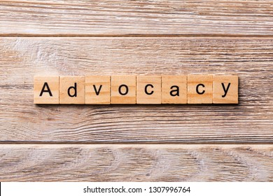 ADVOCACY word written on wood block. ADVOCACY text on wooden table for your desing, concept?