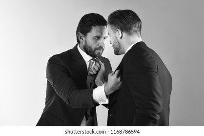 Advocate fights for clients interests. Defend interests, legal services concept. Lawyers support. Business people boxing in formal suits. Aggression, hate, political revenge. Brutal, rude, angry men