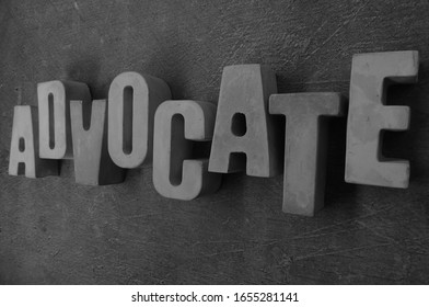 Advocate, word from concrete with background.