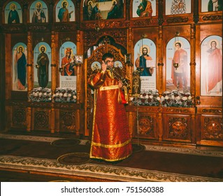 Adygea, Russia - November 8, 2017: a young deacon censes the censer before the altar at the divine Liturgy in the Orthodox Church