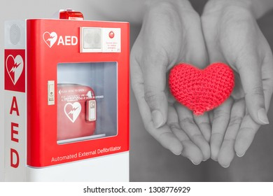 AED or Automated External Defibrillator first aid help giving life heart concept