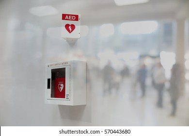 AED Automated External Defibrillator sign at an airport. double exposure