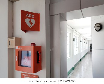 AED box or Automated External Defibrillator medical first aid device on white wall and background - It is portable electronic device that automatically diagnoses the life-threatening cardiac arrest