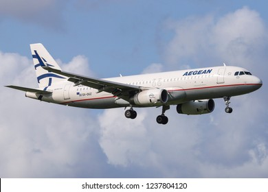 Aegean Airlines Airbus A320 with registration SX-DGZ is landing at Amsterdam Schiphol Airport during a summer day. Aegean connects Athens to Amsterdam. Amsterdam, Netherlands - August 30, 2018