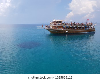 Aegean Sea, Ayvalik, Turkey - July 26, 2018 - Happy tourists and friends diving from sailing boat into the sea - Young people jumping inside ocean while on summer vacation at a distant beach - Cruise