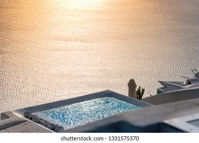 Aegean sea and pool at sunset - Thira - Santorini island - Greece