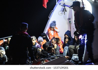 AEGEAN SEA, TURKEY - OCTOBER 18, 2019: Turkish coast guard caught immigrants. Refugees and Migrants aboard dinghies reach the Greek Island of Lesbos after crossing the Aegean sea from Turkey.