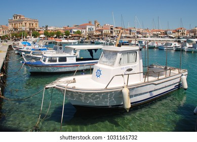 AEGINA, GREECE - APRIL 26, 2017: Small boats moored in the harbour at Aegina Town on the Greek island of Aegina. Less than an hour from Piraeus, the island is a popular destination for Athenians.