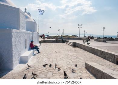 AEGINA, GREECE - MAY 30: Small Greek chapel at Aegina harbor on May 30, 2009 in Aegina. Aegina is a Greek island in the Aegean sea belonging to the Saronic islands.