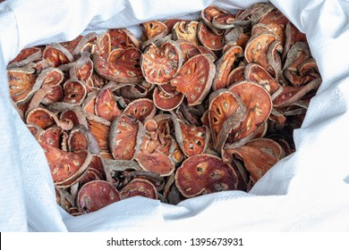 Aegle marmelos. Dried Bael fruit in plastic background.