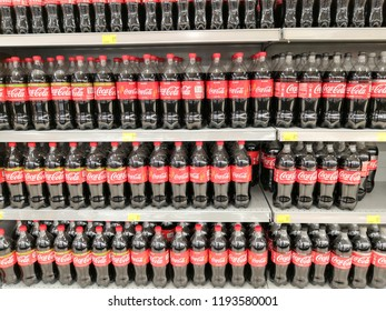 AeonBig, Selangor, Malaysia - September 2018: Coke in bottles on row of shelf display for sale in supermarket. Coca-Cola, or Coke is a carbonated soft drink manufactured by The Coca-Cola Company.