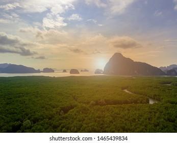 Aerail view Beautiful archipelago during morning at Samed Nang Chee viewpoint, Phang Nga, Thailand. Sun flare effect.