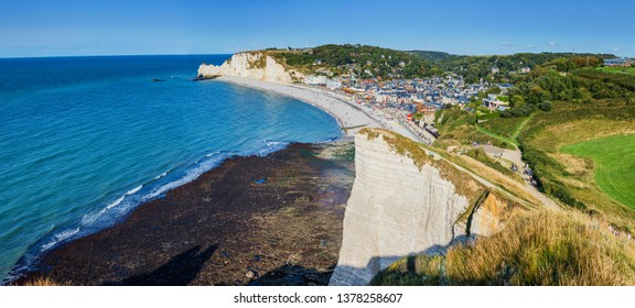 Aeral view of Beautiful landscape on the cliff, city of Etretat and the English Channel in sunny spring day. Etretat, Seine-Maritime department, Normandy, France. Panorama