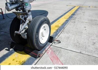 Aereplane Wheel Chock for Pause Aeroplane Safety in The Airport.Aeroplane Wheel Chock made from Black Rubber and Metal.