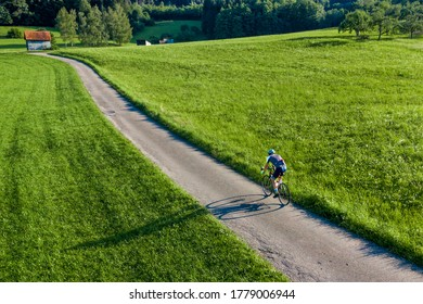 aeriael view of a cyclist in a rural scenery