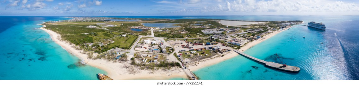 Aerial 180 degree panorama of the entire island of Grand Turk with cruise ship in the harbor.
