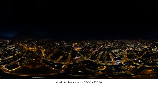 Aerial 360 degree spherical panorama photo taken at night above the Leeds City Centre in West Yorkshire UK
