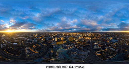 Aerial 360 degree spherical panorama photo taken at sunrise in early morning in to Leeds City Centre in West Yorkshire UK