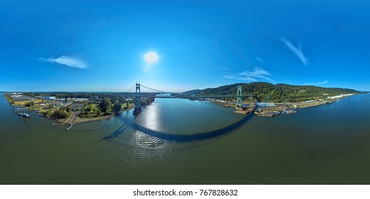 Aerial 360 Panorama of the St Johns Bridge on a blue sky, sunny day in Portland Oregon during Aug 2017
