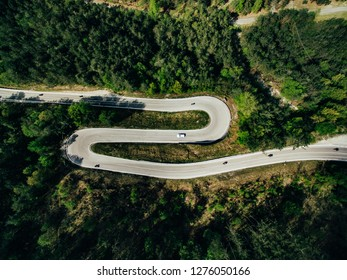 Aerial above view of a rural mountain landscape with a curvy road in Italy. Drone photography