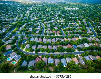 aerial amazing gorgeous view over Central Texas suburb housing community with rows of homes and thousands of new houses suburbia Austin Texas USA