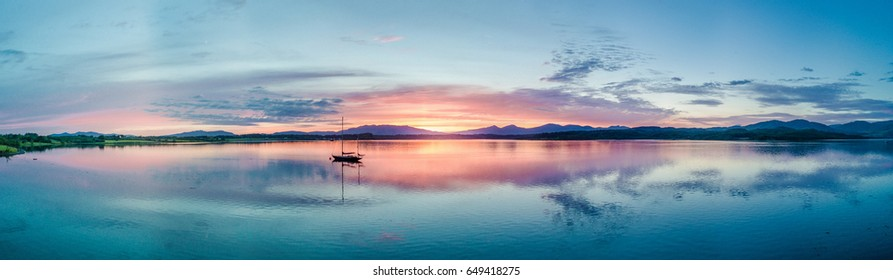 Aerial of an amazing sunset with sailing vessel at Loch Creran, Barcaldine, Argyll,Scotland