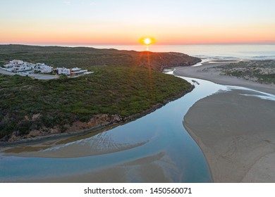Aerial from Amoreira beach on the westcoast in Portugal at sunset