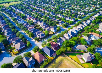 Aerial Austin Texas USA colorful rooftops on box houses and suburb new development