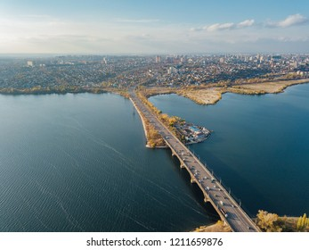 Aerial autumn Voronezh cityscape from drone flight height. View of the bridge over  Voronezh Water Reservoir.