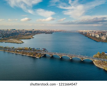 Aerial autumn Voronezh cityscape from drone flight height. View of the bridge over  Voronezh Water Reservoir