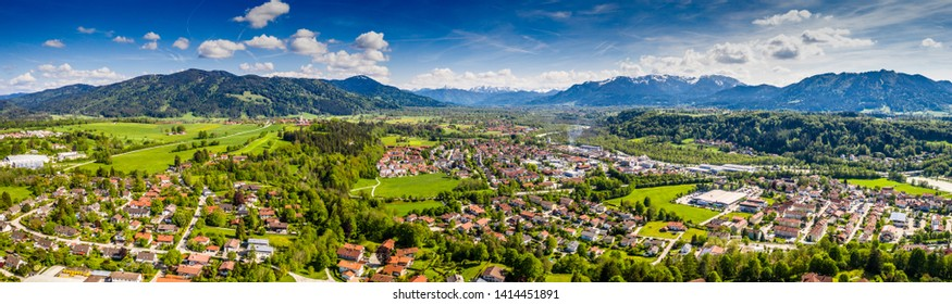 Aerial Bad Toelz Bavarian Alps in May. Old Town, Mountains, Isar River. Beautiful Travel destination