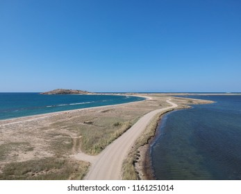 aerial beach and dirt road view