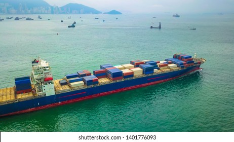 Aerial bird eye view drone photography Cargo ship departing from Hong Kong's industrial port.Logistics and transportation of Container Cargo ship logistic import export in HONG KONG