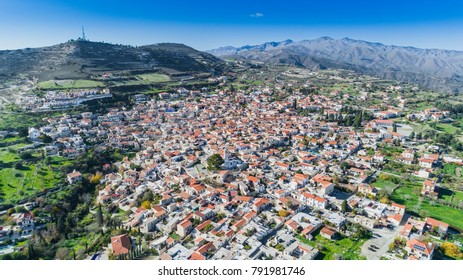 Aerial bird eye view of famous landmark tourist destination valley Pano Lefkara village, Larnaca, Cyprus. Ceramic tiled house roofs, greek orthodox church at south of Troodos hills, Kionia, from above