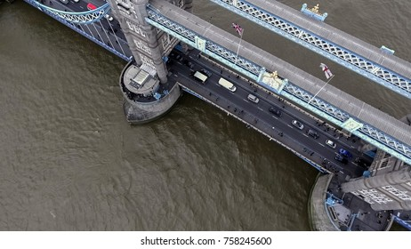 Aerial Bird Eye View of Iconic Tower Bridge with Traffic Transportation and River Thames in London England, UK 4K