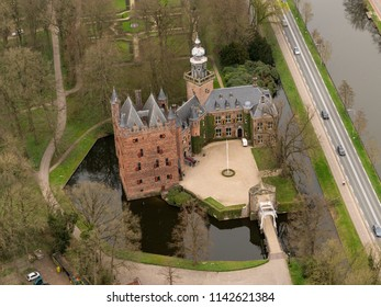 Aerial bird view of medieval castle and school Nijenrode in the countryside from the Netherlands. It is a famous University for future Captains of Industry