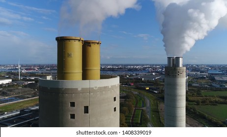 Aerial bird view photo of coal fired power station exhaust flues located at thermal plant which burns a fossil fuel to produce electricity by converting heat of combustion into mechanical energy